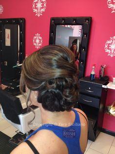Side-swept updo on prom girls hair