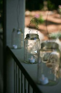 Mason jars wired with flickering battery operated candles so they wont blow out!