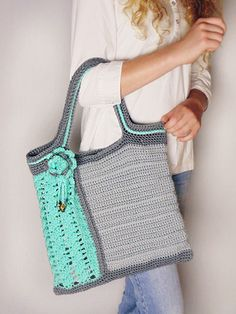 This crochet Sea Glass Tote design is perfect for the on-the-go girl. Made with medium (worsted) weight yarn.