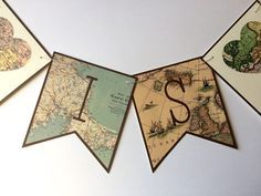 Map Banner, Travel Banner, Bridal Shower Banner, Bridal Shower Map Banner, Travel Theme Banner, Map Bunting, Vintage Map Banner by Sweet Talk Designs  Love is in the air with this old world style map banner, constructed from digital map paper. Pennants measure approximately 5x5.5, are printed on 100 lb cream linen card stock, and come strung on ivory jute twine. Words are separated by heart map pennants. Perfect for a travel themed bridal or baby shower!  IDEAS FOR BANNER TEXT: Love Is In…