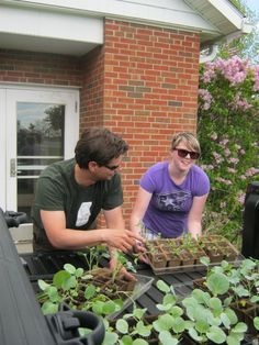 Aaron Zweig (with Alexis Lull '13 moving seedlings from the greenhouse to the garden) is the Director of the Food Studies Program.