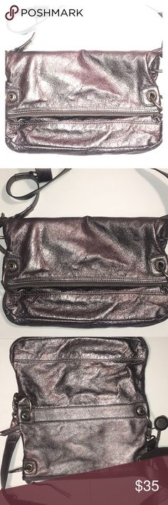 The Sak silver clutch or cross bag The Sak silver clutch or cross bag can you take off the shoulder straps and make into a clutch folds over has two pockets can adjust the straps from short to long has minor nicks hardly noticeable inside small blemishes The Sak Bags Crossbody Bags