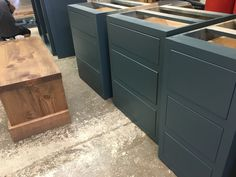 Base drawer units being put together. Painted Shaker kitchens from Cobwebs Furniture Company.