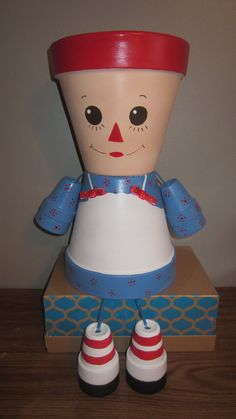 'Planter Pot Person Garden Friend':  Raggedy Ann;  planters are made from terra-cotta clay pots & stand aprox 10 tall.    - made by GardenFriendsNJ on Etsy