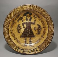 """http://www.pbauctioneers.co.uk/photos/1503 : Staffordshire Slipware Pottery with a cross hatched border incorporating the signature of Thomas Toft and framing a central portrait of king Charles II. 17"""" diameter."""