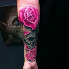 Rose and skull tattoo on the arm