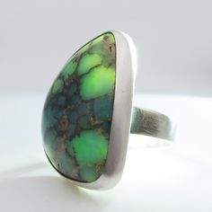 I do custom work too. This is a special order Seven Dwarfs translucent turquoise. Contact me with your ideas!
