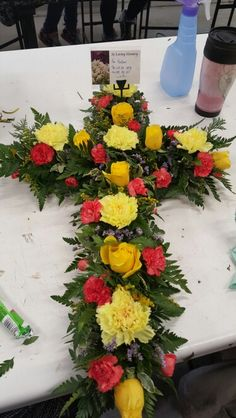 Loose cross with carnations and roses
