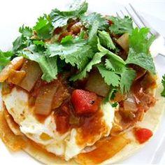 This is our new favorite weekend breakfast!  YUMMMMMMMMMM!!!!!  Authentic Huevos Rancheros Allrecipes.com