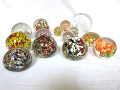 There are flowers, different designs and colors, all wonderful pieces to add to your collection. Round shape, one is a clear eagle that can lay flat or stand on it's side. Christmas Shopping Online, Paper Weights, Eagle, Shapes, Glass, Flowers, Beautiful, Vintage, Design
