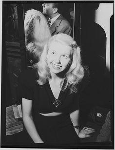 [Portrait of Doris Day and Les Brown, Aquarium, New York, N.Y., ca. July 1946] (LOC). Back of head.
