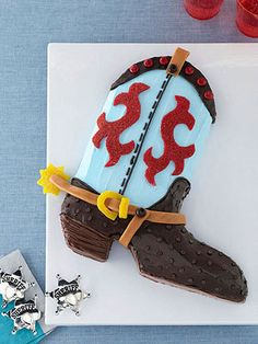 Cowboy Cool: Tip your hat to the Wild West with this boot-shaped cake, complete with caramel candy straps and gumdrop designs you can customize with the birthday cowpoke's favorite colors.
