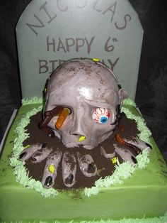"Zombie Cake  This is disturbing. Would have to change the tombstone. Maybe ""Zombie Apocalypse Is Now"" I dunno.  What would you put on the tombstone?"
