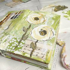 My art journal progress, adding gorgeous sunny flowers - reminiscent of old roses - shabby flowers.  Mixed media art journal.