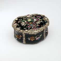 Snuffbox, 1775-80, Berlin ~ Artist Jean Guillaume George Kruger. The item is made of carved bloodstone, gold, emeralds and diamonds (some coloured, some with foil backing), and cut glass. (The Rosalinde and Arthur Gilbert Collection on loan to the Victoria and Albert Museum, London).