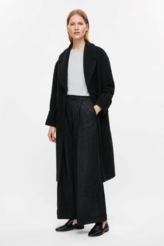 COS image 1 of Oversized coat with fold-up sleeves in Black