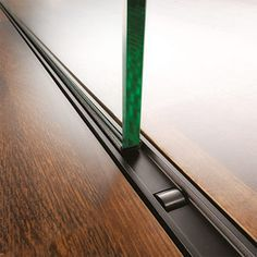 b.400 : wheels carry the weight of large glass or wood panels up to 880 lbs on tracks set flush to the finished floor.