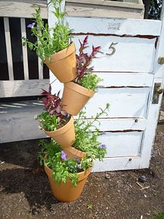 Tipsy pots planter. DARLING! Dad's wife made one & it's sooo easy. I can see mine with coleus in it! Herb Garden, Garden Plants, Lawn And Garden, Backyard Plants, Garden Projects, Garden Ideas, Yard Art, Container Gardening, Gardening Tips