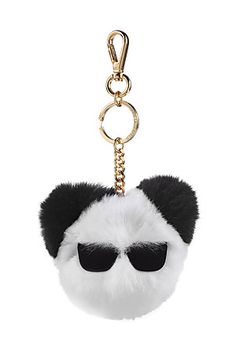 Nothing says playful luxury like a rabbit fur keychain from Karl Lagerfeld - and this black and white accessory is sure to catch stares with its too-cool sunglasses motif #Stylebop