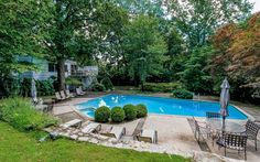 gorgeous yard and pool with abundant room for entertaining.