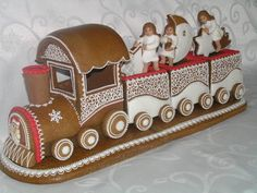 Topperland specialises in making Toppers for celebration cakes as well as ornamental figurines. Topperland specialises in making Toppers for celebration cakes as well as ornamental figurines. Gingerbread Train, Gingerbread Village, Christmas Gingerbread House, Christmas Sweets, Noel Christmas, Christmas Goodies, Christmas Baking, Gingerbread Cookies, Christmas Crafts