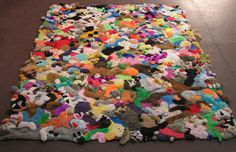 i really NEED this....or need to make one of my own....toooooo cute....LOL!!!<3 nightengale rug.....toy pelts with embedded squeakers ...5 x 8 ft....by mary johnson...... :-)