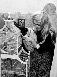 BB showing Guapa the parrots c.1958. Photographed by Luc Fournol