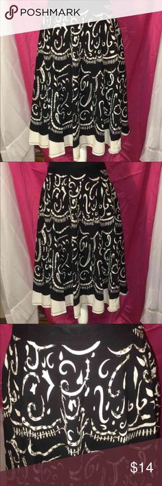 NWOT MAGIC BLACK & WHITE SEQUIN SKIRT SZ LG This beautiful skirt has a Spanish theme to it with the white and black design with the sequin throughout it and I zipper on the side and is a size large and is 26 inches from the waist and on the bottom there is a white band of fabric! Magic Skirts A-Line or Full