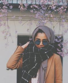 Pinterest: @eighthhorcruxx. Grey hijab, checked scarf, tan leather jacket and sunglasses. @malikaofficial