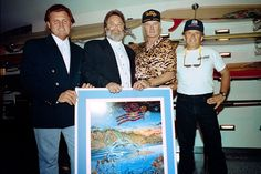 From left Bruce Johnston Carl Wilson Mike Love and Al Jardine of the US band the Beach Boys pose with a poster of their new album cover at the...