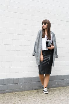 "Outfit details: oversized cardigan – & other Stories [similar here] top – Zara leather skirt – Zara sneakers – Converse Chucks  bag – Céline Trio sun glasses – Ray-Ban ""Round Metal"""