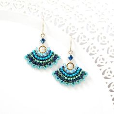 I created this blue dangle earrings by hand, using Swarovski beads Miyuki round seed beads, Miyuki Delica beads and goldfilled Ear-wire Unique, fun and fashion look. * Measurements: Earring length: Fan element diameter: * The earrings will come Black Earrings, Seed Bead Earrings, Etsy Earrings, Women's Earrings, Earrings Handmade, Seed Beads, Bead Jewellery, Beaded Jewelry, Swarovski Crystal Earrings