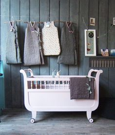 nursery. i actually dont do nurseries...but this is cute..as a concept. i love the raw wood. and those hanging bunting bags are too cute. nursery too far away for me:) i need babies avec MOI!!!