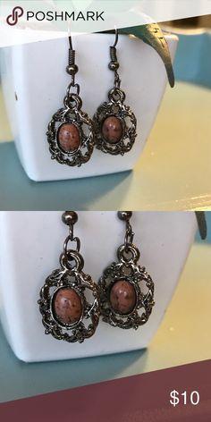 Vintage natural stone dangle earrings Vintage gun metal dangle earrings with a natural stone peachy tan center Vintage Jewelry Earrings