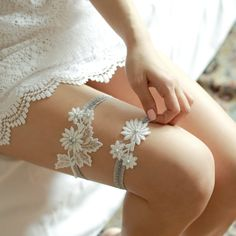 STYLE - #407 CODE:GRT027 Lace blue daisy garter. Dainty lace garter set features floral cotton lace appliques  embellished with glass pearls.  The appliques are securely hand-sewn to beaded ruffle elastic band. Very light something blue to wear under your dress. To order yours contact us at loca@localoca.co.za www.localoca.co.za