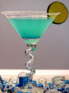 hpnotiq breeze | 2 ounces hpnotiq liqueur 1 ounce coconut rum splash of pineapple juice ice sugar for the rim of glass garnish: lime, rock candy, pineapple, anything (optional) | dip the rim of a glass into pineapple juice (or water) and then dip in sugar. add hpnotiq, coconut rum and pineapple juice to a cocktail shaker.  add enough ice to the shaker to cool down the mixture. put the lid on and shake until well mixed. pour through the strainer into your favorite glass.