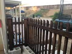 Cinder block & wood fence. Easy way to make a fence without digging. Use the cinder block to cement the posts in. Will be filling in the open cinder blocks with large rock and painting the block to match out patio.