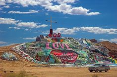 Salvation Mountain in Salton Sea, CA - Seen it in person but did not get up close. My husband actually walked on it. Smaller than it looks but still impressive work. Salton Sea California, Southern California, California Usa, The Places Youll Go, Places To See, Salvation Mountain, Coachella Valley, Palm Desert, Adventure Is Out There