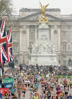 The London Marathon - runners enter the Mall in front of Buckingham Palace