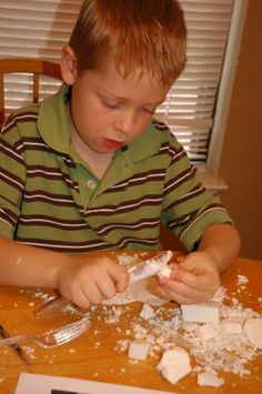 Carving soap with plastic utensils - looks like fun - he made arrowheads.