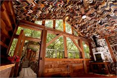 "I love this guy ! ...Thousands of picture frame corners were used to create the ceiling at left. Mr. Phillips said, ""A frame shop was getting rid of old samples and I was there waiting."" The Recycled Houses - The New York Times > Home & Garden > Slide Show > Slide 8 of 19"