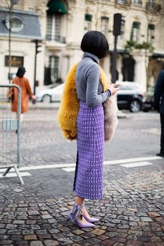 Lilac skirt and boots with a grey turtleneck and yellow fur
