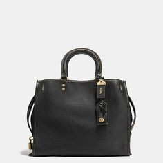 Inspired by the Coach girl, the aptly named Rogue is exceptionally well crafted in glovetanned pebble leather with a luxe suede lining in the two outer compartments. Top handles and removable straps allow you to carry this spacious satchel in hand or wear