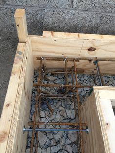 Steel rebar & threaded bar detail before pouring concrete strip foundation. Note washers to prevent shuttering plywood from spreading on pour.