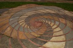 """One of a series of """"inserts"""" in the ground at Leicester Harold Martin Botanic Garden that are dedicated to the Fibonacci series. It's a mathematical """"pattern"""" that lies behind much of the natural world. It governs the Golden section, it controls the twist of a spiral shell or the layout of seeds on a sunflower's head. It's simple - just add together the previous two numbers to get the next in the series. It's also beautiful."""