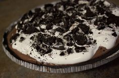lazy college kid pie: prebaked oreo crust. chocolate pudding mixed with whipped cream. whipped cream. crushed oreos.