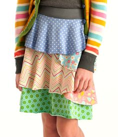 Tabitha Skirt  Named after half of MJC's most dynamic sisterly duo, the Tabitha Gentry Skirt has as much spunk and sassiness as her namesake! Asymmetrical layers of MJC's world-famous knit fabric make this updated piece a breeze to mix and match. Pair with a rib-knit tank and a smile for a look that your girl will want to wear all season long. Item #: B1581 $50.00