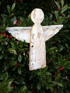 Angel tree topper for the perfect rustic Christmas tree decoration. These are cut from old white siding and have a leather strap from a local Amish leather workers scrap pile nailed onto the back to hold it on the tree. $25