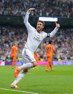 Sergio Ramos celebrates after scoring his team's first goal during the La Liga match between Real Madrid CF and Valencia CF at Estadio Santiago Bernabéu on May 4, 2014 in Madrid, Spain.