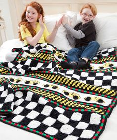 Here's a throw for kids that are into cars! This graphic crochet design can set the tone for a great bedroom décor or kept at grandma's for a homey touch away from home.